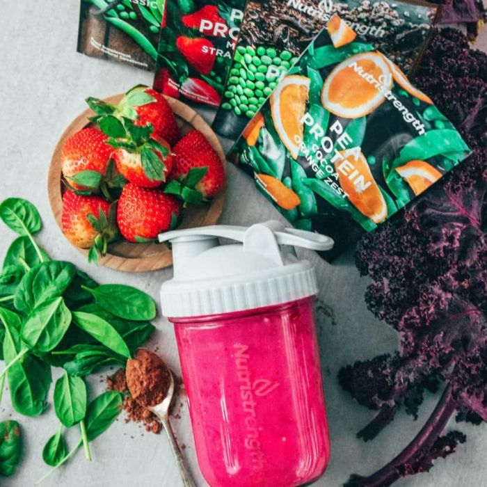 vegan protein shake and glass water bottle
