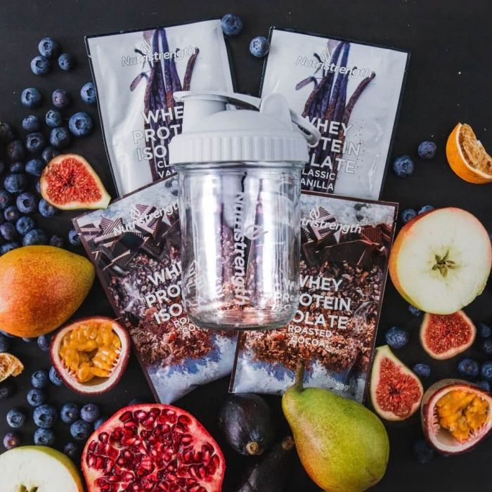 glass water bottle and whey protein sachets